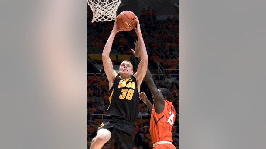 Iowa's forward Aaron White (30) shoots while being guarded by Illinois' Kendrick Nunn (25) during an NCAA college basketball game in Champaign, Ill., Saturday, Feb. 1, 2014. (AP Photo/Robin Scholz)