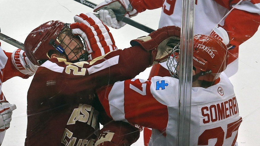 Boston College's Bill Arnold fights Boston University's Doyle Somerby in the second period of the Beanpot college hockey tournament game in Boston, Monday, Feb. 3, 2014. (AP Photo/The Boston Herald, Matthew West) BOSTON GLOBE OUT; METRO BOSTON OUT; MAGS OUT; ONLINE OUT