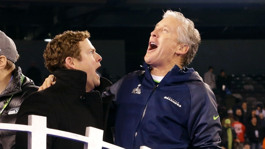 Seattle Seahawks head coach Pete Carroll, right, celebrates with general manager John Schneider after the NFL Super Bowl XLVIII football game against the Denver Broncos Sunday, Feb. 2, 2014, in East Rutherford, N.J. The Seahawks won 43-8. (AP Photo/Ted S. Warren)