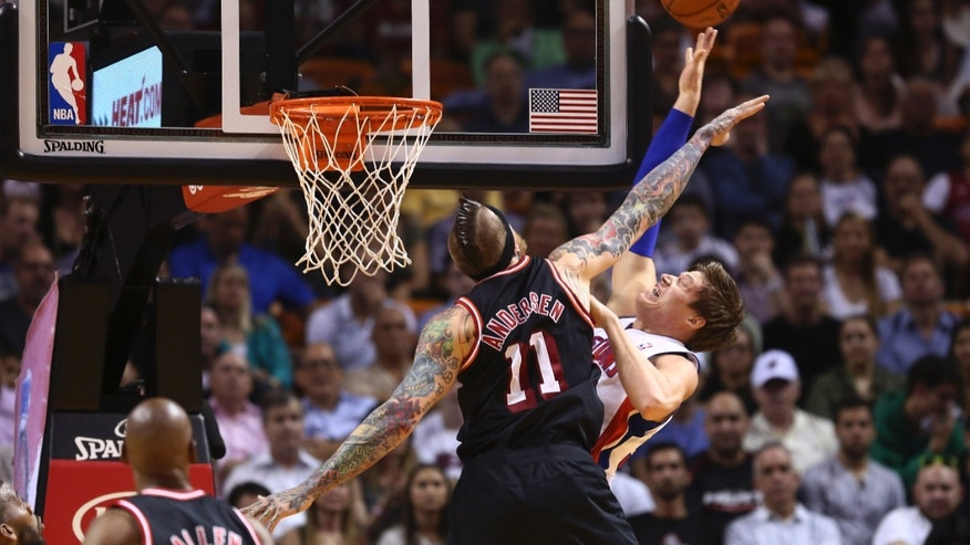 Miami Heat's Chris Andersen (11) blocks a shot by Detroit Pistons' Jonas Jerebko (33) during the first half of a NBA basketball game in Miami, Monday, Feb. 3, 2014.  (AP Photo/J Pat Carter)