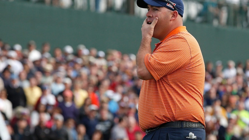 Kevin Stadler watches Bubba Watson miss a putt on the 18th hole, making Stadler the winner during the final round of the Phoenix Open golf tournament on Sunday, Feb. 2, 2014, in Scottsdale, Ariz. (AP Photo/Ross D. Franklin)
