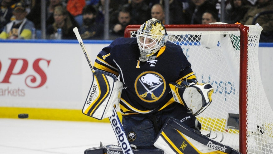 Buffalo Sabres goaltender Jhonas Enroth, of Sweden, gets beat for a goal from Edmonton Oilers' Justin Schultz during the second period of an NHL hockey game in Buffalo, N.Y., Monday, Feb 3, 2014. (AP Photo/Gary Wiepert)