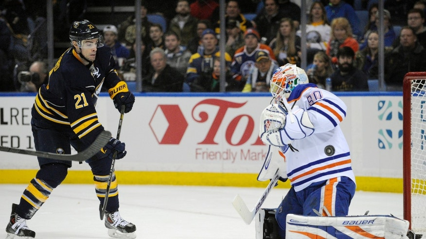 Buffalo Sabres right winger Drew Stafford (21) watches his shot deflect off Edmonton Oilers goaltender Ilya Bryzgalov (80), of Russia, during the first period of an NHL hockey game in Buffalo, N.Y., Monday, Feb 3, 2014. (AP Photo/Gary Wiepert)