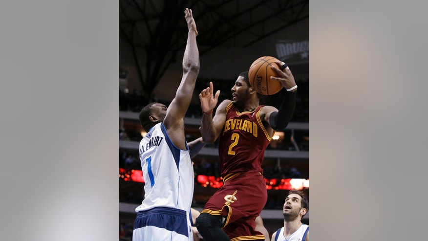 Dallas Mavericks' Samuel Dalembert (1) of Haiti defends as Cleveland Cavaliers' Kyrie Irving (2) leaps to the basket for a shot attempt in the first half of an NBA basketball game, Monday, Feb. 3, 2014, in Dallas. (AP Photo/Tony Gutierrez)