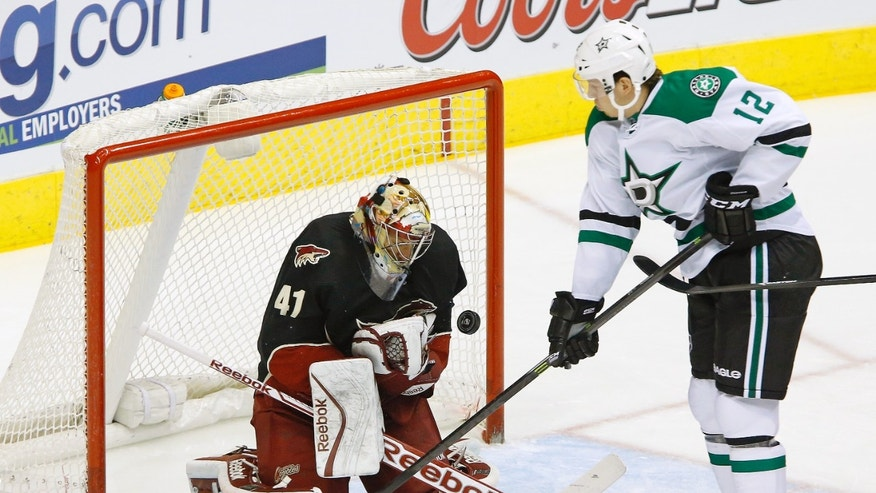 Phoenix Coyotes goalie Mike Smith (41) makes a save against Dallas Stars right wing Alex Chiasson (12) during the first period of their NHL hockey game, Tuesday, Feb. 4, 2014 in Glendale. (AP Photo/The Arizona Republic, David Kadlubowski)