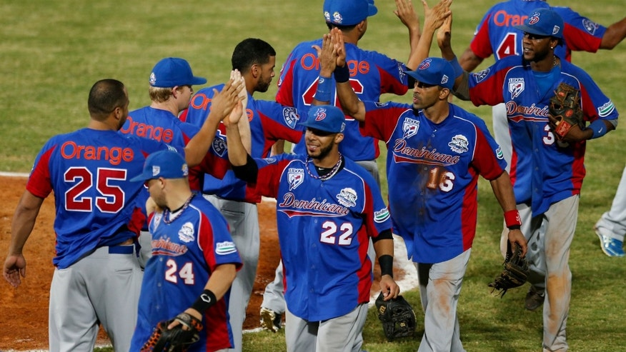 Players of the Dominican Republic celebrate after they defeated Cuba 9-2 during a Caribbean Series game in Porlamar, Venezuela, Feb. 3, 2014.