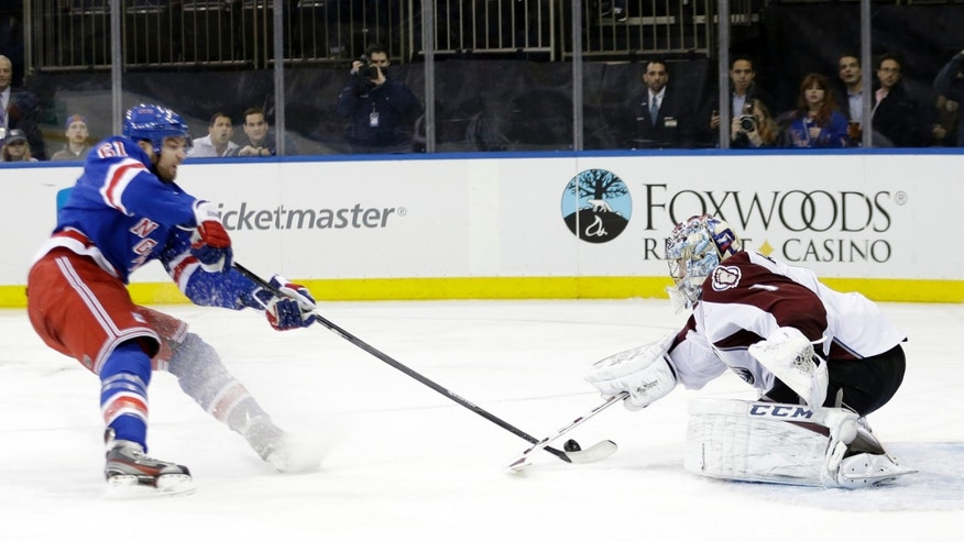 Colorado Avalanche's Semyon Varlamov (1) stops a shot-on-goal by New York Rangers' Rick Nash (61) during the second period of an NHL hockey game, Tuesday, Feb. 4, 2014, in New York. (AP Photo/Frank Franklin II)