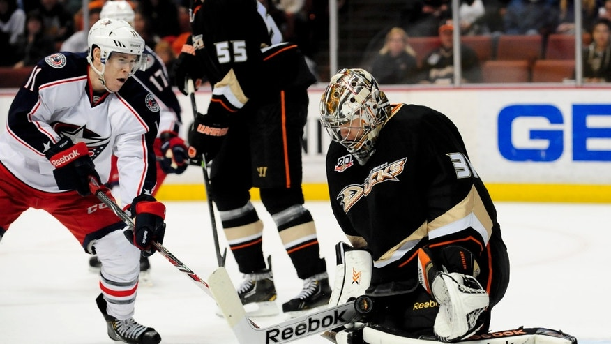 Anaheim Ducks goalie Frederik Andersen (31), of Denmark, blocks a shot from Columbus Blue Jackets left wing Matt Calvert (11) during the first period of an NHL hockey game, Monday, Feb. 3, 2014, in Anaheim, Calif. (AP Photo/Gus Ruelas)
