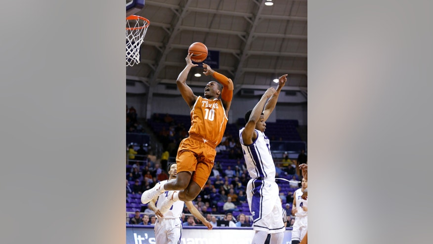 Texas forward Jonathan Holmes gets past TCU forward Brandon Parrish (11) to take a shot during the first half of an NCAA college basketball game Tuesday, Feb. 4, 2014, in Fort Worth, Texas. (AP Photo/Sharon Ellman)