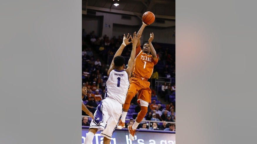 TCU center Karviar Sheperd (1) defends on a shot by Texas guard Isaiah Taylor during the first half of an NCAA college basketball game Tuesday, Feb. 4, 2014, in Fort Worth, Texas. (AP Photo/Sharon Ellman)