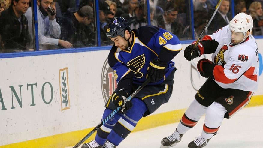 St. Louis Blues' Roman Polak (46) skates around Ottawa Senators' Clarke MacArthur (16) during the first period of an NHL hockey game, Tuesday, Feb. 4, 2014, in St. Louis. (AP Photo/Bill Boyce)