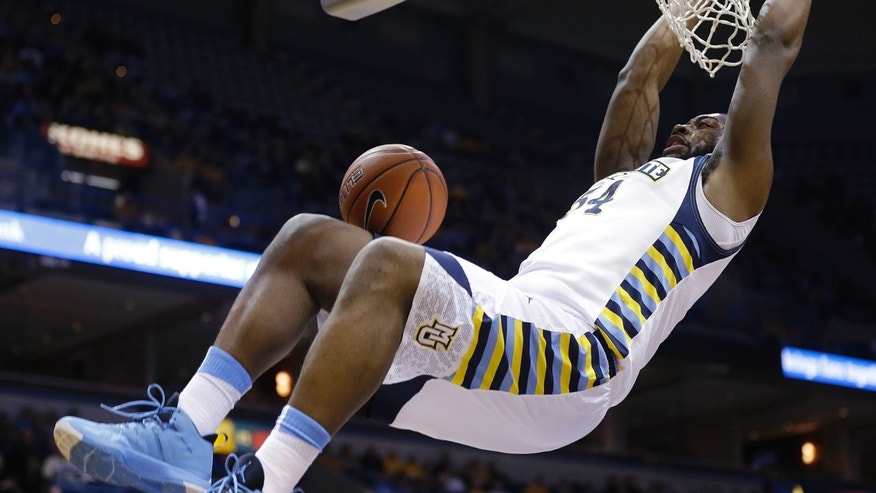 Marquette's Davante Gardner dunks against Butler during the first half of an NCAA college basketball game, Tuesday, Feb. 4, 2014, in Milwaukee. (AP Photo/Jeffrey Phelps)