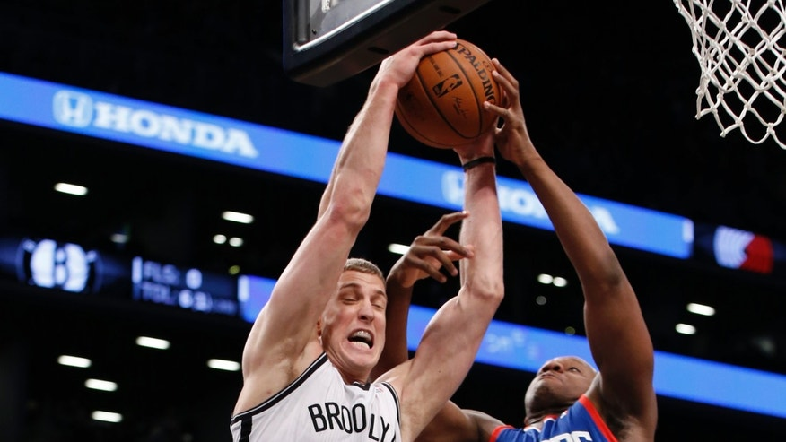 Philadelphia 76ers power forward Lavoy Allen (50) tries to grab a rebound from Brooklyn Nets forward Mason Plumlee (1) in the first half of their NBA basketball game at the Barclays Center, Monday, Feb. 3, 2014 in New York. (AP Photo/Kathy Willens)