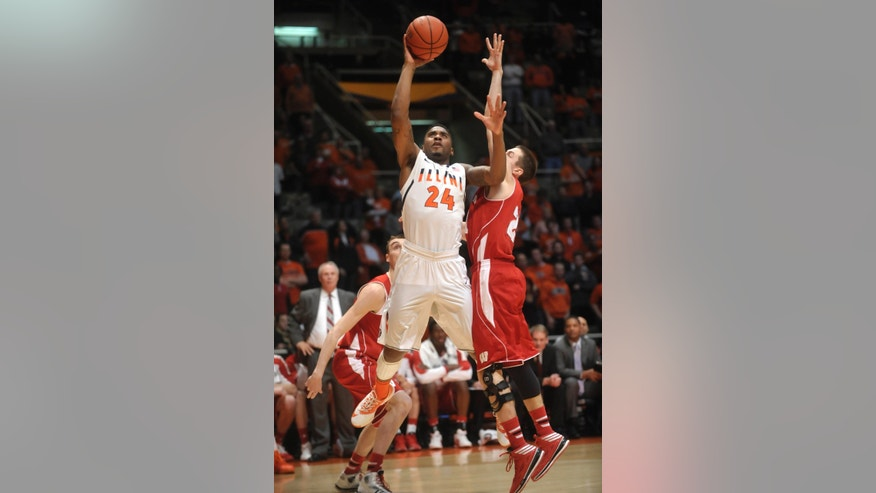 Illinois guard Rayvonte Rice (24) shoots over Wisconsin guard Josh Gasser (21) during the first half of an NCAA college basketball game Tuesday, Feb. 4, 2014, in Champaign, Ill. (AP Photo/Rick Danzl)