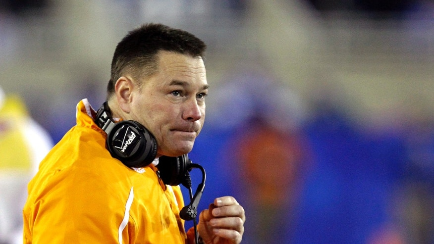 FILE- In this file photo from Nov. 30, 2013, Tennessee first-year coach Butch Jones watches his team against Kentucky in an NCAA college football game in Lexington, Ky. (AP Photo/Garry Jones, File)