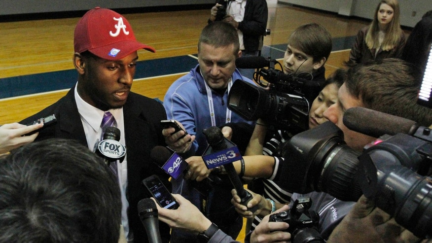 Rashaan Evans talks with the media after the Auburn High School football player announced that he will attend Alabama during a national signing day ceremony on Wednesday, Feb. 5, 2014, in Auburn, Ala. (AP Photo/Butch Dill)