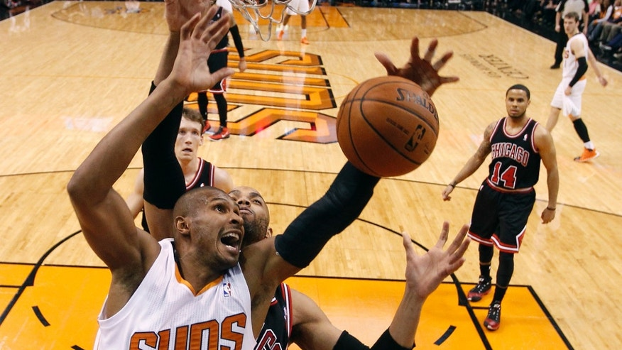 Phoenix Suns guard Leandro Barbosa (10) loses the ball as Chicago Bulls' Taj Gibson defends during the first quarter of an NBA basketball game, Feb. 4, 2014, in Phoenix. (AP Photo/The Arizona Republic, Michael Chow)