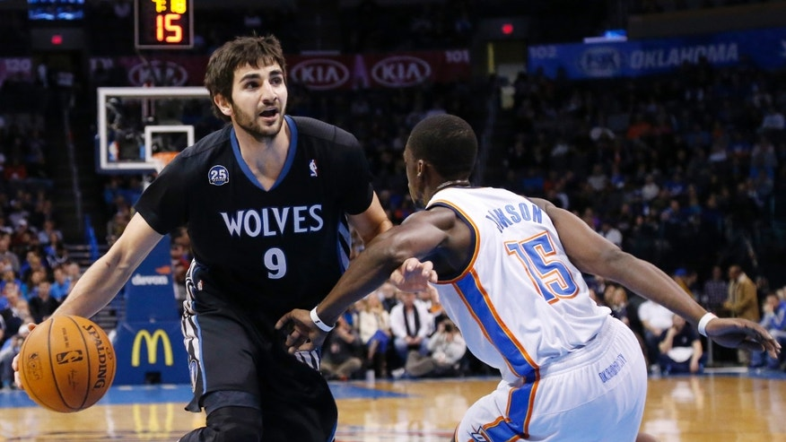 Minnesota Timberwolves guard Ricky Rubio (9) is fouled by Oklahoma City Thunder guard Reggie Jackson (15) as he drives during the first quarter of an NBA basketball game in Oklahoma City, Wednesday, Feb. 5, 2014. (AP Photo/Sue Ogrocki)
