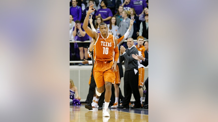 Texas forward Jonathan Holmes celebrates after a 3-point shot during the second half of an NCAA college basketball game against TCU on Tuesday, Feb. 4, 2014, in Fort Worth, Texas. Texas won 59-54. (AP Photo/Sharon Ellman)