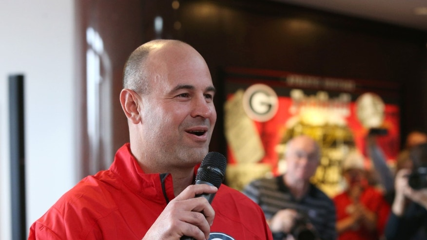 Georgia defensive coordinator Jeremy Pruitt answers questions from fans about Georgia's recruiting class on national signing day Wednesday, Feb. 5, 2014, in Athens, Ga. (AP Photo/Jason Getz)