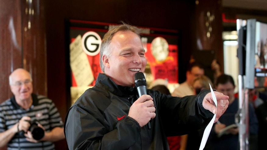 Georgia football coach Mark Richt answers questions from fans about Georgia's recruiting class on national signing day Wednesday, Feb. 5, 2014, in Athens, Ga. (AP Photo/Jason Getz)
