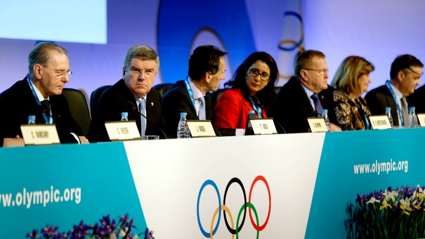 International Olympic Committee President Thomas Bach, second from left, opens the IOC's general assembly at the 2014 Winter Olympics, Wednesday, Feb. 5, 2014, in Sochi, Russia. (AP Photo/David Goldman)