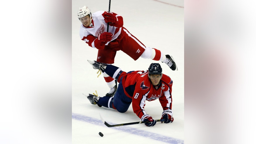 Washington Capitals right wing Alex Ovechkin (8), from Russia, collides with Detroit Red Wings center Gustav Nyquist (14), from Sweden, in the overtime period of an NHL hockey game on Sunday, Feb. 2, 2014, in Washington. The Capitals won 6-5. (AP Photo/Alex Brandon)