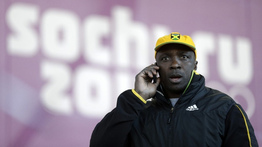 Feb. 5, 2014: Winston Watts, the driver for JAM-1 of Jamaica, speaks on the phone after arriving at the sliding center during a training session for the men's two-man bobsled at the 2014 Winter Olympics in Krasnaya Polyana, Russia.