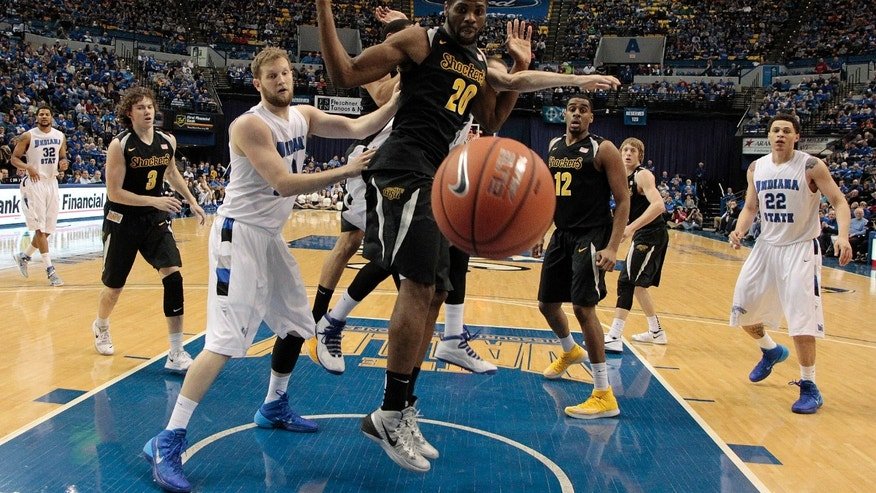 Wichita State center Kadeem Coleby (20) watches the ball go out of bounds in front of Indiana State forward Jake Kitchell during the first half of an NCAA college basketball game in Terre Haute, Ind., Wednesday, Feb. 5, 2014. (AP Photo/AJ Mast)