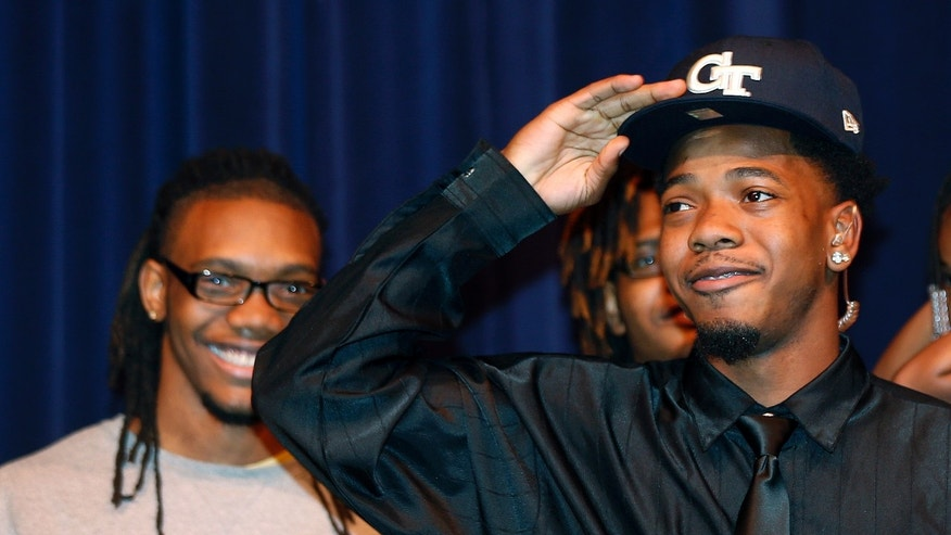 Norcross High School running back Myles Autry, right, announces that he plans attend Georgia Tech and play football, as his brother, and Georgia Tech receiver, Anthony Autry smiles during a news conference Wednesday, Feb. 5, 2014, in Norcorss, Ga.  (AP Photo/John Bazemore)
