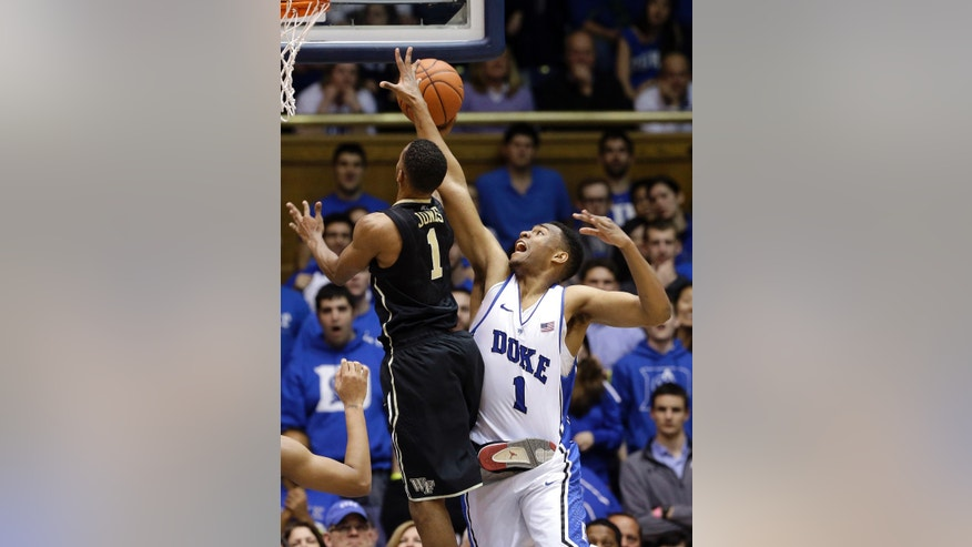 Duke's Jabari Parker (1) defends as Wake Forest's Madison Jones (1) drives to the basket during the first half of an NCAA college basketball game in Durham, N.C., Tuesday, Feb. 4, 2014. (AP Photo/Gerry Broome)