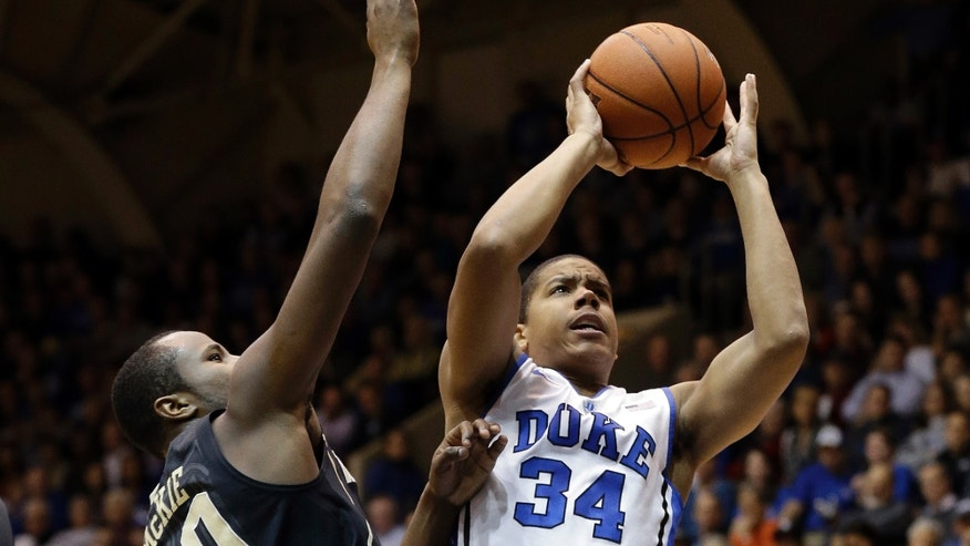 Duke's Andre Dawkins (34) drives to the basket as Wake Forest's Travis McKie (30) defends during the first half of an NCAA college basketball game in Durham, N.C., Tuesday, Feb. 4, 2014. (AP Photo/Gerry Broome)