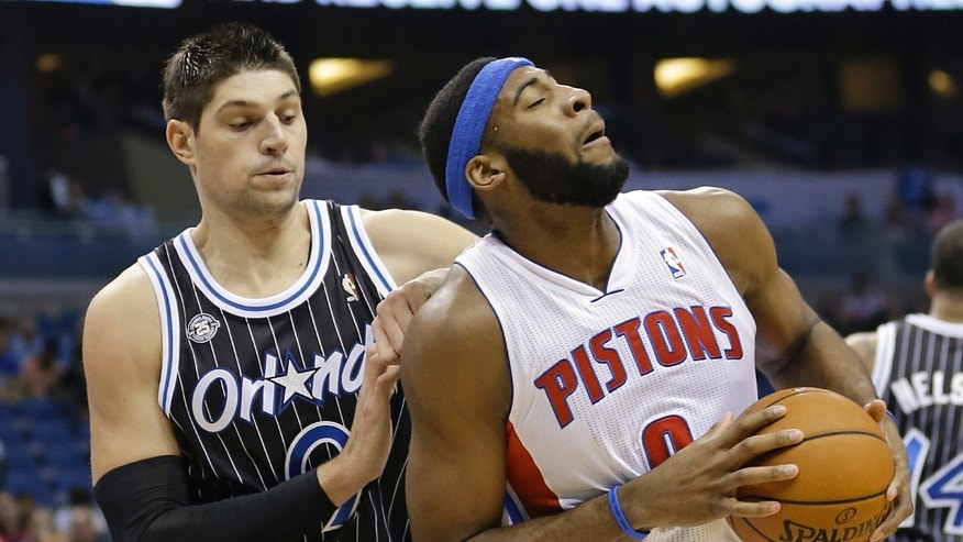 Detroit Pistons' Andre Drummond, right, makes a move to get around Orlando Magic's Nikola Vucevic during the first half of an NBA basketball game in Orlando, Fla., Wednesday, Feb. 5, 2014. (AP Photo/John Raoux)