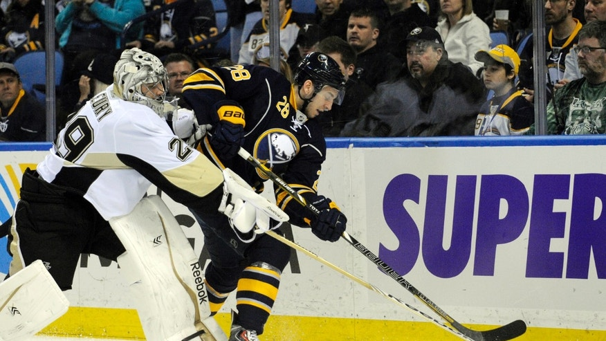 Pittsburgh Penguins'  Marc-Andre Fleury (29) battles for the puck with Buffalo Sabres' Zemgus Girgensons (28) during the first period of an NHL hockey game in Buffalo, N.Y., Wednesday, Feb. 5,  2014. (AP Photo/Gary Wiepert)