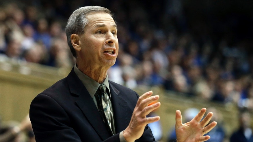 Wake Forest coach Jeff Bzdelik reacts during the first half of an NCAA college basketball game against Duke in Durham, N.C., Tuesday, Feb. 4, 2014. Duke won 83-63. (AP Photo/Gerry Broome)