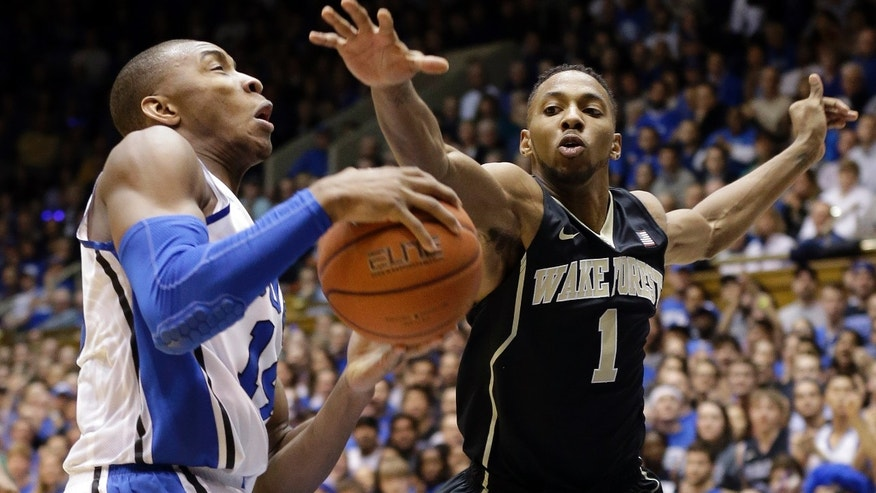Duke's Rasheed Sulaimon, left, drives to the basket as Wake Forest's Madison Jones (1) defends during the first half of an NCAA college basketball game in Durham, N.C., Tuesday, Feb. 4, 2014. (AP Photo/Gerry Broome)