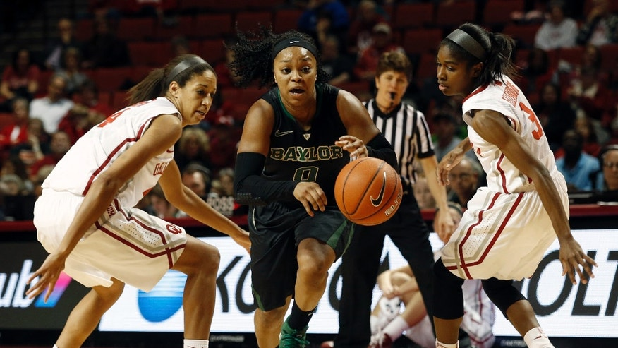 Baylor's Odyssey Sims (0) drives the ball past Oklahoma's Nicole Griffin (4) and Aaryn Ellenberg (3) during the first half of an NCAA college basketball game in Norman, Okla., Feb. 3, 2014. (AP Photo/Garett Fisbeck)