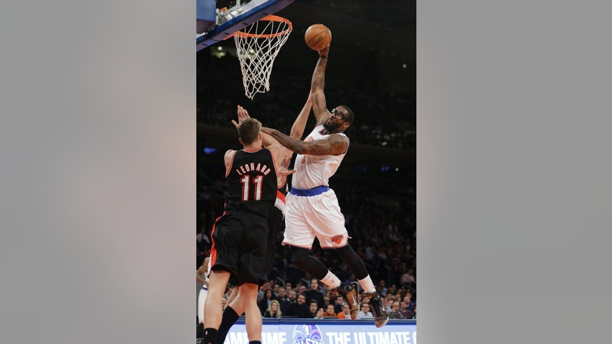 New York Knicks' Amar'e Stoudemire (1) dunks the ball on Portland Trail Blazers' Meyers Leonard (11) during the first half of an NBA basketball game, Wednesday, Feb. 5, 2014, in New York. (AP Photo/Frank Franklin II)