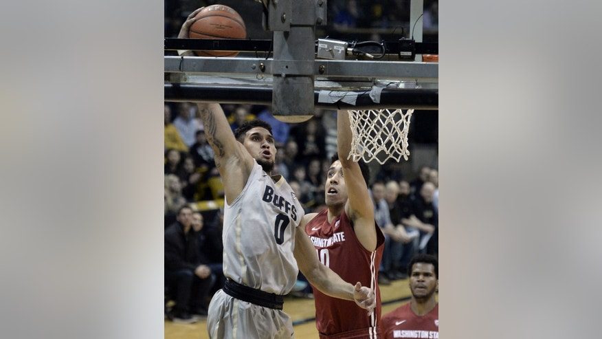 Colorado's Askia Booker, left, dunks over Washington State's Dexter Kernich-Drew during an NCAA basketball game on Wednesday, Feb. 5, 2014, in Boulder, Colo. (AP Photo/The Daily Camera, Jeremy Papasso) NO SALES