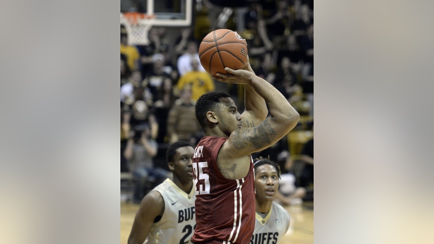 Washington State's Davonte Lacy shoots in front of Colorado's Xavier Johnson and Jaron Hopkins during an NCAA basketball game on Wednesday, Feb. 5, 2014, in Boulder, Colo. (AP Photo/The Daily Camera, Jeremy Papasso) NO SALES