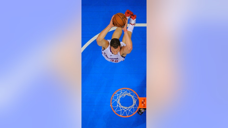 Los Angeles Clippers forward Blake Griffin goes up for a dunk during the first half of an NBA basketball game against the Miami Heat, Wednesday, Feb. 5, 2014, in Los Angeles. (AP Photo/Mark J. Terrill)