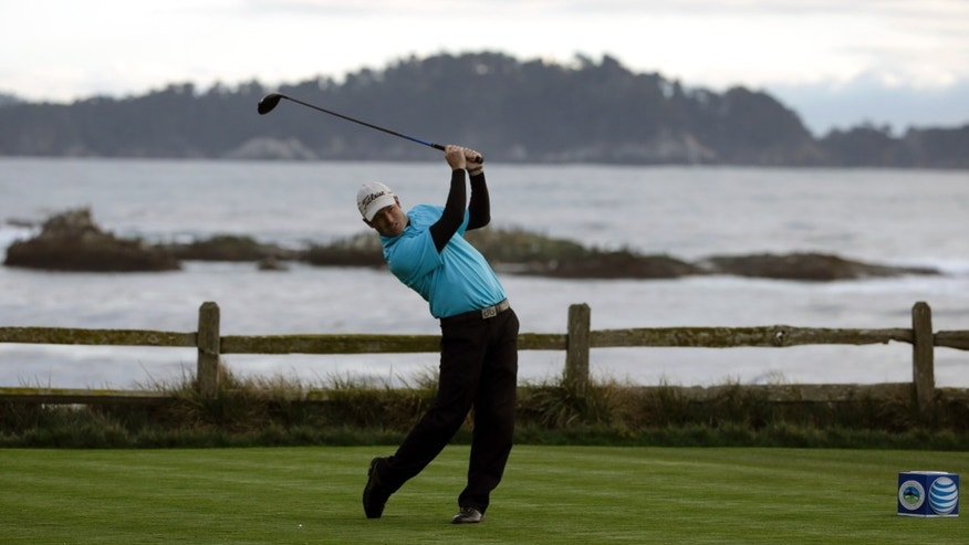 Robert Streb follows through on his shot off the 18th tee on Thursday, Feb. 6, 2014, during the first round of the AT&T Pebble Beach Pro-Am golf tournament on the Pebble Beach Golf Links in Pebble Beach, Calif. (AP Photo/Ben Margot)