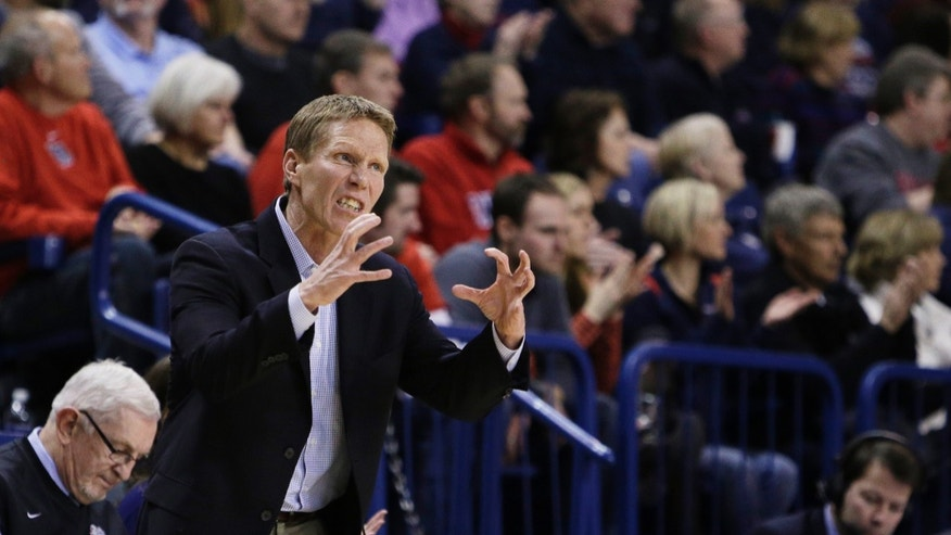 Gonzaga's Head Coach Mark Few instructs his team during the first half of an NCAA college basketball game against Portland, on Wednesday, Feb. 5, 2014, in Spokane, Wash. (AP Photo/Young Kwak)
