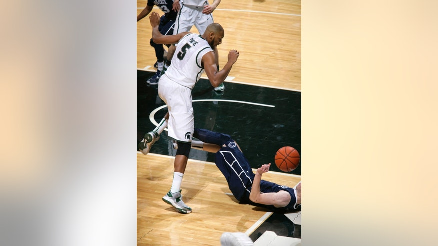 Michigan State's Adreian Payne (5) and Penn State's Donovon Jack, right, vie for a loose ball during the first half of an NCAA college basketball game on Thursday, Feb. 6, 2014, in East Lansing, Mich. (AP Photo/Al Goldis)