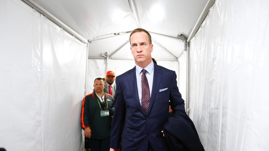Broncos quarterback Peyton Manning enters MetLife Stadium before facing the Seahawks in Super Bowl XLVIII in East Rutherford, N.J., Sunday, Feb. 2, 2014. (AP Photo/The Seattle Times, John Lok)
