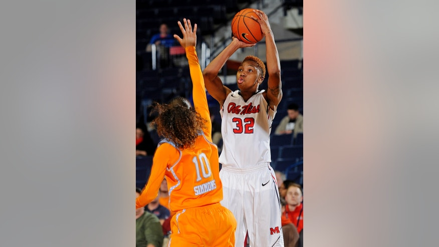 Mississippi forward Tia Faleru (32) goes up for a shot past Tennessee guard Meighan Simmons (10) during the first half of an NCAA college basketball game in Oxford, Miss., Thursday, Feb. 6, 2014. (AP Photo/Thomas Graning)