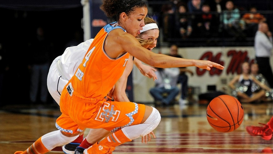 Tennessee guard Andraya Carter (14) and Mississippi guard Gracie Frizzell dive for the ball during the first half of an NCAA college basketball game in Oxford, Miss., Thursday, Feb. 6, 2014. (AP Photo/Thomas Graning)