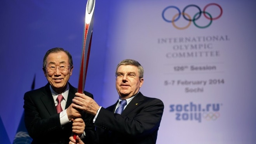 Feb. 6, 2014: United Nations Secretary-General Ban Ki-moon, left, is presented with an Olympic torch by International Olympic Committee President Thomas Bach, right, after Ban addressed the IOC's general assembly ahead of the upcoming 2014 Winter Olympics in Sochi, Russia.