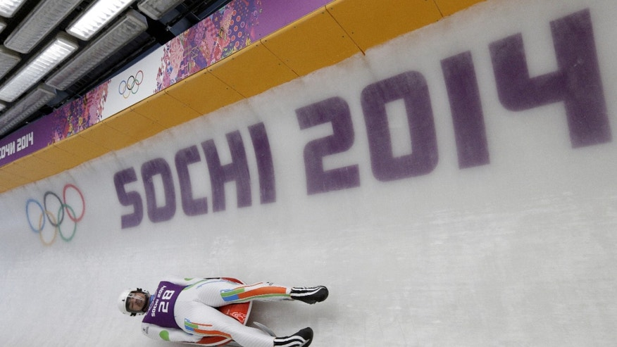 Feb. 6, 2014: Shiva Keshavan, who if from India but is competing under the Olympics flag, takes a turn during a training session for the men's singles luge at the 2014 Winter Olympics.