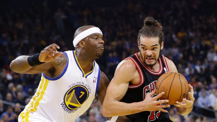Chicago Bulls' Joakim Noah (13) dribbles next to Golden State Warriors' Jermaine O'Neal (7) during the first half of an NBA basketball game, Thursday, Feb. 6, 2014, in Oakland, Calif. (AP Photo/Marcio Jose Sanchez)